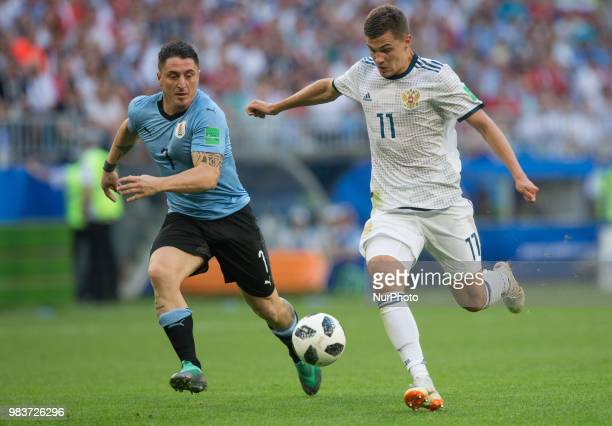 Cristian Rodriguez of Uruguay vies Roman Zobnin of Russia during the 2018 FIFA World Cup Russia group A match between Uruguay and Russia at Samara...