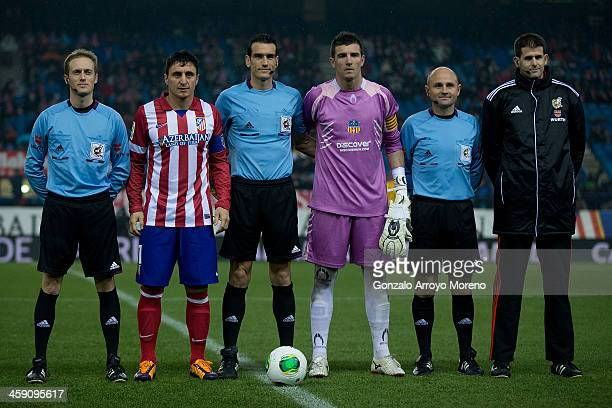Cristian Rodriguez poses with goalkeeper Jose Miguel Morales of UE Sant Andreu and the referee team lead by referee Juan Martinez Munuera prior to...