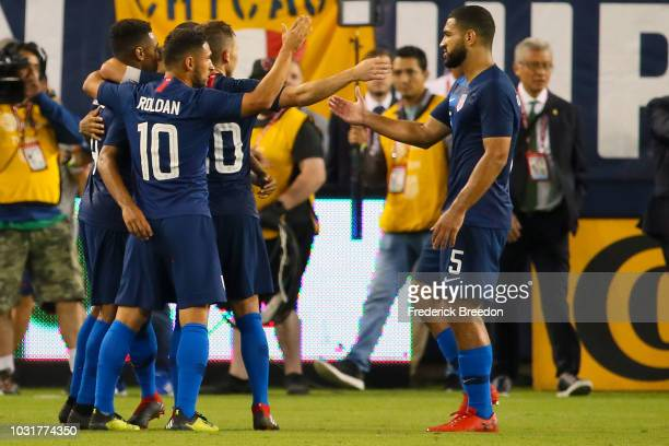 Cristian Roldan and Cameron CarterVickers of the USA celebrate a 10 victory over of Mexico at Nissan Stadium on September 11 2018 in Nashville...