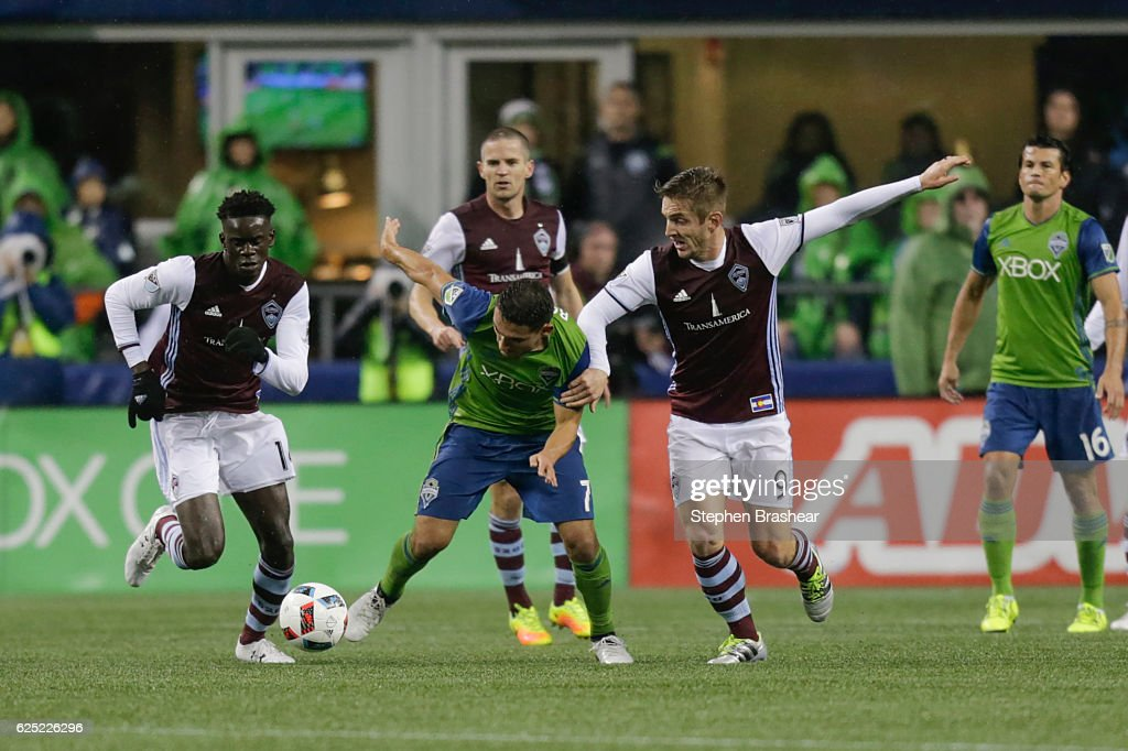 Cristian Roldan #7, center of the Seattle Sounders battles Dominique Badji #14, left, of the Colorado Rapids and Kevin Doyle #9, right, of the Colorado Rapids for the ball during the first half of a match in the first leg of the Western Conference Finals at CenturyLink Field on November 22, 2016 in Seattle, Washington. The Sounders won the match 2-1.