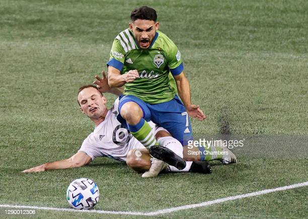 Cristian Roldan of Seattle Sounders and Chase Gasper of Minnesota United battle for the ball in the second half during the Western Conference Final...