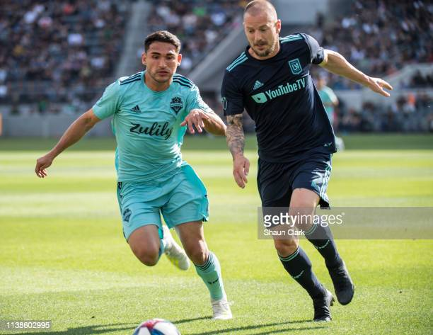 Cristian Roldan of Seattle Sounders battles Jordan Harvey of Los Angeles FC during Los Angeles FC's MLS match against Seattle Sounders at the Banc of...
