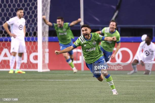 Cristian Roldan of Seattle Sounders celebrates a goal by Gustav Svensson in the 93rd minute against Minnesota United during their Western Conference...