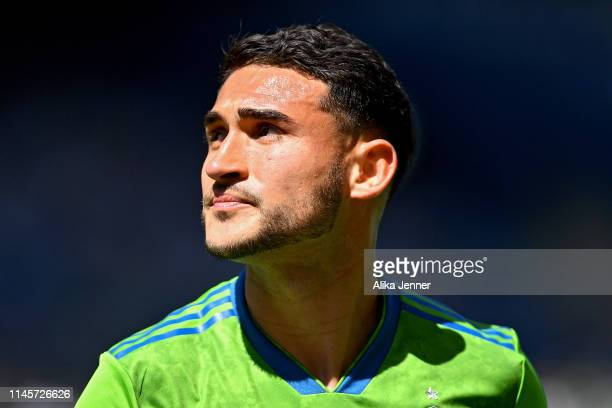 Cristian Roldan of Seattle Sounders looks at the crowd as he leaves the match ejected for violent conduct during the first half of the match at...
