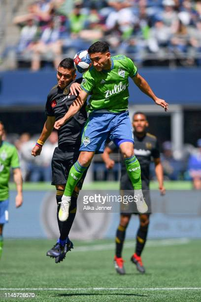Cristian Roldan of the Seattle Sounders battles for a header against Eduard Atuesta of the Los Angeles FC during the match at CenturyLink Field on...
