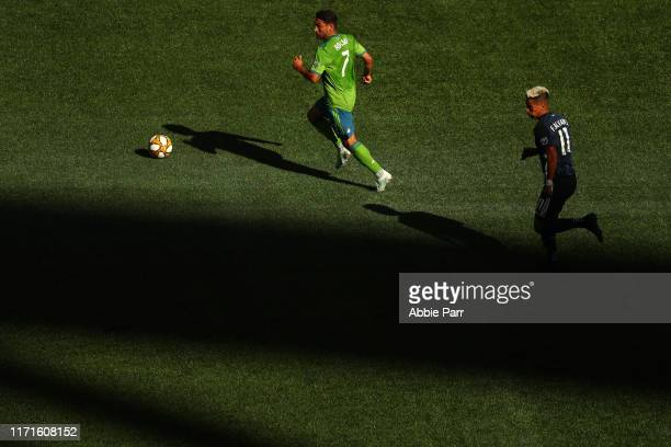 Cristian Roldan of the Seattle Sounders dribbles with the ball against Favio Alvarez of the Los Angeles Galaxy in the first half during their game at...
