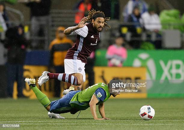 Cristian Roldan of the Seattle Sounders goes to the ground while fighting for the ball with Jermaine Jones of the Colorado Rapids during the first...