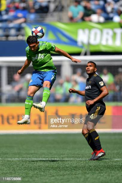Cristian Roldan of the Seattle Sounders leaps for a header against Eddie Segura of the Los Angeles FC during the match at CenturyLink Field on April...