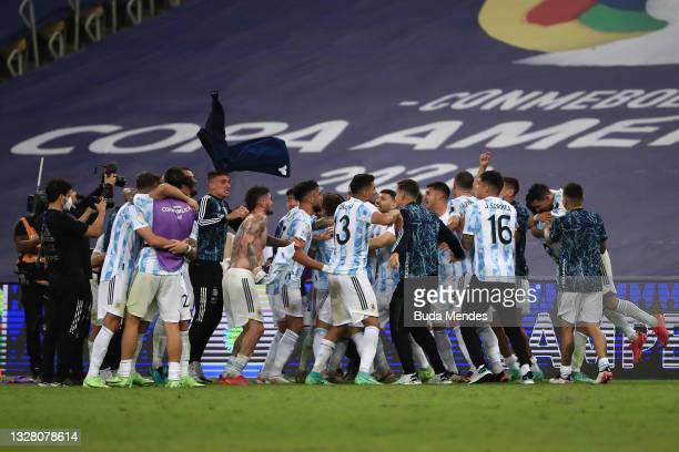 Cristian Romero of Argentina and teammates celebrate after winning the final of Copa America Brazil 2021 between Brazil and Argentina at Maracana...