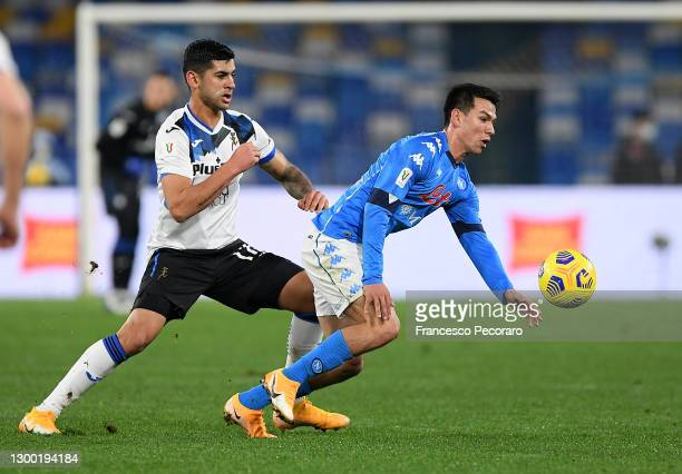Cristian Romero of Atalanta B.C. Battles for possession with Hirving Lozano of SSC Napoli during the Coppa Italia match between SSC Napoli and...
