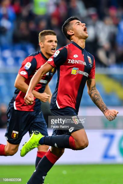 Cristian Romero of Genoa celebrates with his team-mate Darko Lazovic of Genoa after scoring a goal during the Serie A match between Genoa CFC and...