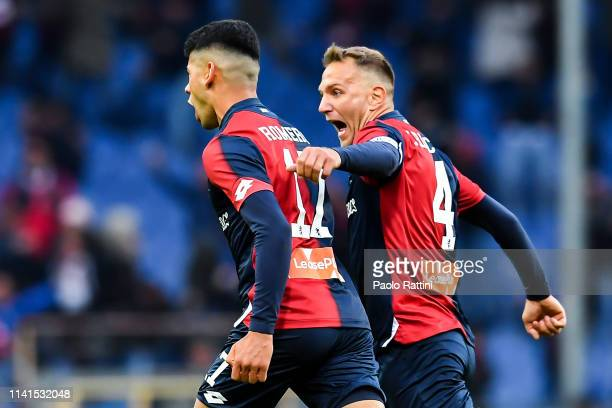 Cristian Romero of Genoa celebrates with his teammate Domenico Criscito after scoring a goal during the Serie A match between Genoa CFC and AS Roma...