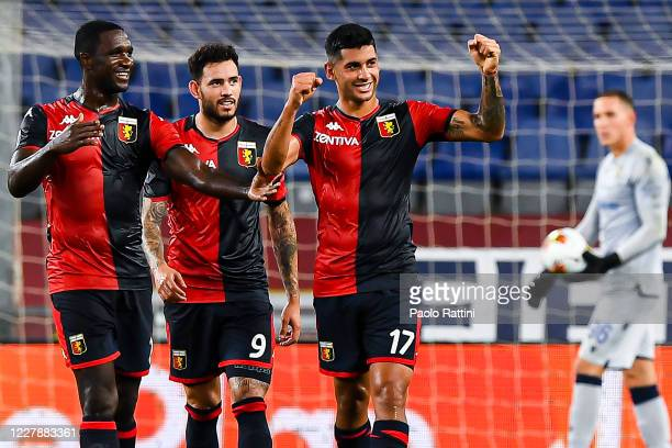 Cristian Romero of Genoa celebrates with his team-mates Cristian Zapata and Antonio Sanabria after scoring a goal during the Serie A match between...