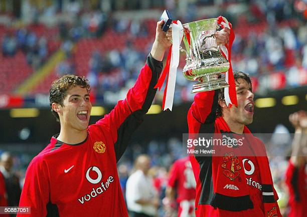 Cristian Ronaldo and Ruud Van Nistleroy of Manchester United hold aloft the trophy after victory over Millwall in the 123rd FA Cup Final between...