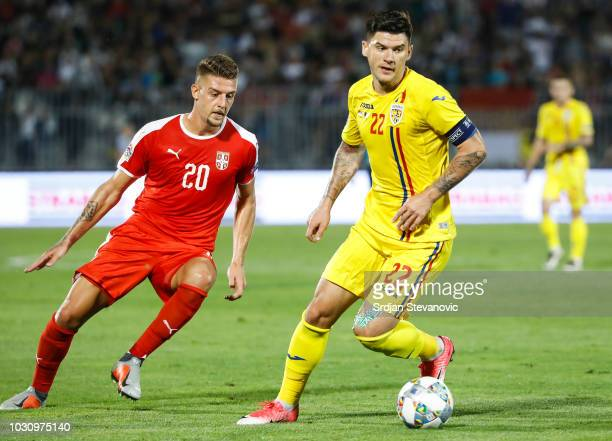 Cristian Sapunaru of Romania in action against Sergej Milinkovic Savic of Serbia during the UEFA Nations League C group four match between Serbia and...