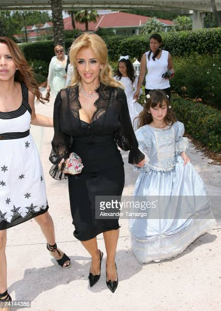 Cristian Solis and daughter Alison and Janine arrive for Charytin Goyco's dream wedding at Walt Disney World at the Grand Floridian wedding pavilion...