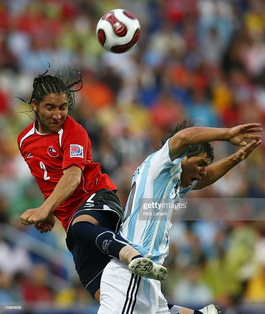 Cristian Suarez #2 of Chile heads the ball against Sergio Aguero #10 of Argentina during their semi-final game at the Fifa U-20 World Cup Canada 2007 at the National Soccer Stadium July 19, 2007 in Toronto, Canada.