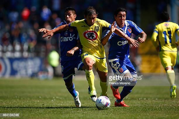 Cristian Suarez of U de Chile fights for the ball with Fabian Vargas of U de Concepcion during a match between U de Concepcion and U de Chile as part...