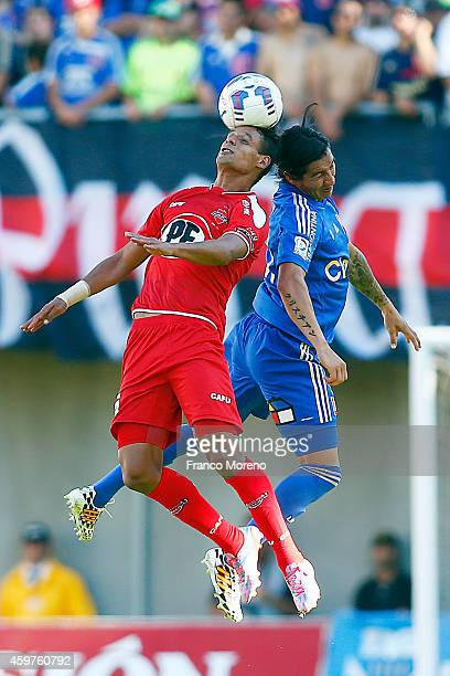Cristian Suarez of Universidad de Chile fights for the ball with Juan Gonzalo Lorca of Nublense during a match between Nublense and Universidad de...