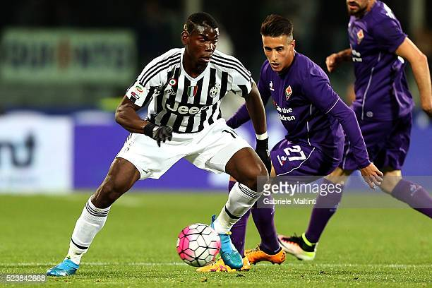 Cristian Tello of ACF Fiorentina battles for the ball with Paul Pogba of Juventus FC during the Serie A match between ACF Fiorentina and Juventus FC...