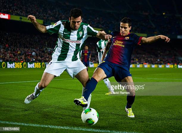 Cristian Tello of FC Barcelona duels for the ball with Juan Rafael Fuentes of Cordoba CF during the Copa del Rey round of sixteen second leg match...