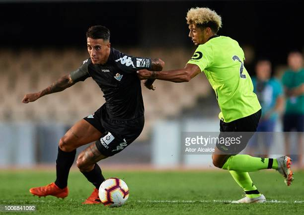 Cristian Tello of Real Betis Balompie being followed by Malcuit of Lille OSC during the Preseason match between Real Betis and Lille OSC at Estadio...