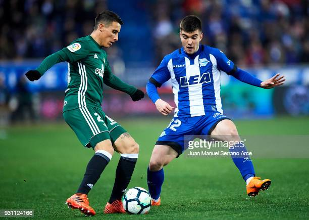 Cristian Tello of Real Betis Balompie duels for the ball with Martin Aguirregabiria of Deportivo Alaves during the La Liga match between Deportivo...