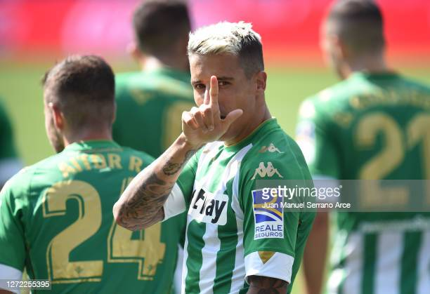 Cristian Tello of Real Betis celebrates after scoring his team's first goal during the La Liga match between Alaves and Real Betis at Estadio de...