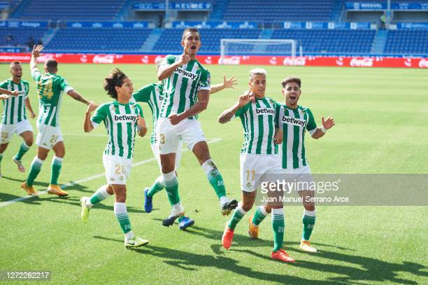 Cristian Tello of Real Betis celebrates with his team mates after scoring his team's first goal during the La Liga match between Alaves and Real...