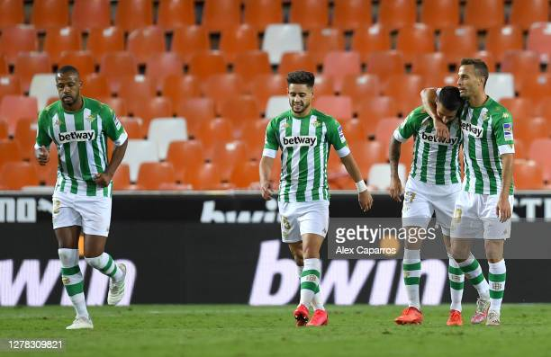Cristian Tello of Real Betis celebrates with teammates after scoring his team's second goal during the La Liga Santander match between Valencia CF...