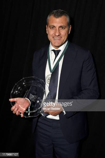 Cristian Vieri poses with an award during the 34th Annual Great Sports Legends Dinner To Benefit The Buoniconti Fund To Cure Paralysis at The Hilton...