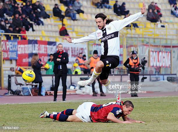 Cristian Zaccardo of Parma FC skips over the challenge from Diego Perez of Bologna FC during the Serie A match between Bologna FC and Parma FC at...