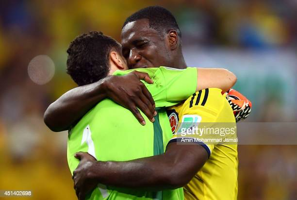 Cristian Zapata and David Ospina of Colombia Celebrate after defeating Uruguay 20 during the 2014 FIFA World Cup Brazil round of 16 match between...