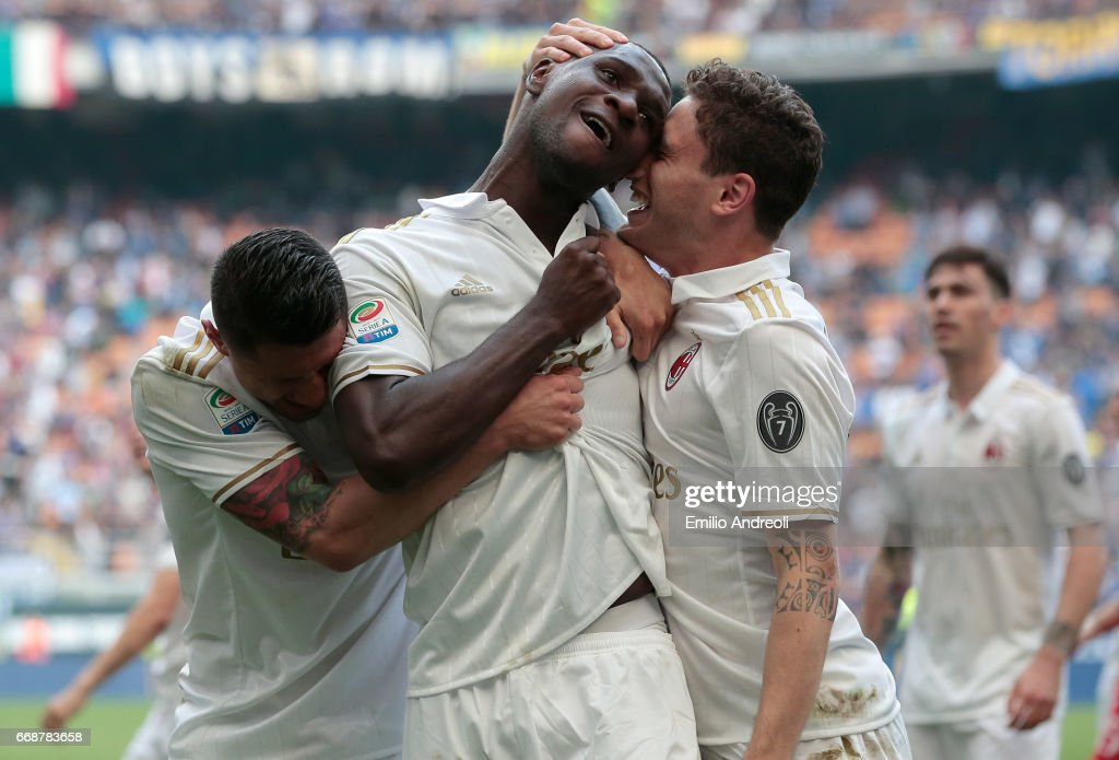 Cristian Zapata of AC Milan (C) celebrates his goal with his team-mate Davide Calabria (R) and Gianluca Lapadula (L) during the Serie A match between FC Internazionale and AC Milan at Stadio Giuseppe Meazza on April 15, 2017 in Milan, Italy.