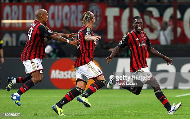 Cristian Zapata of AC Milan celebrates with his team-mates Philippe Mexes and Nigel De Jong after scoring the opening goal during the UEFA Champions...
