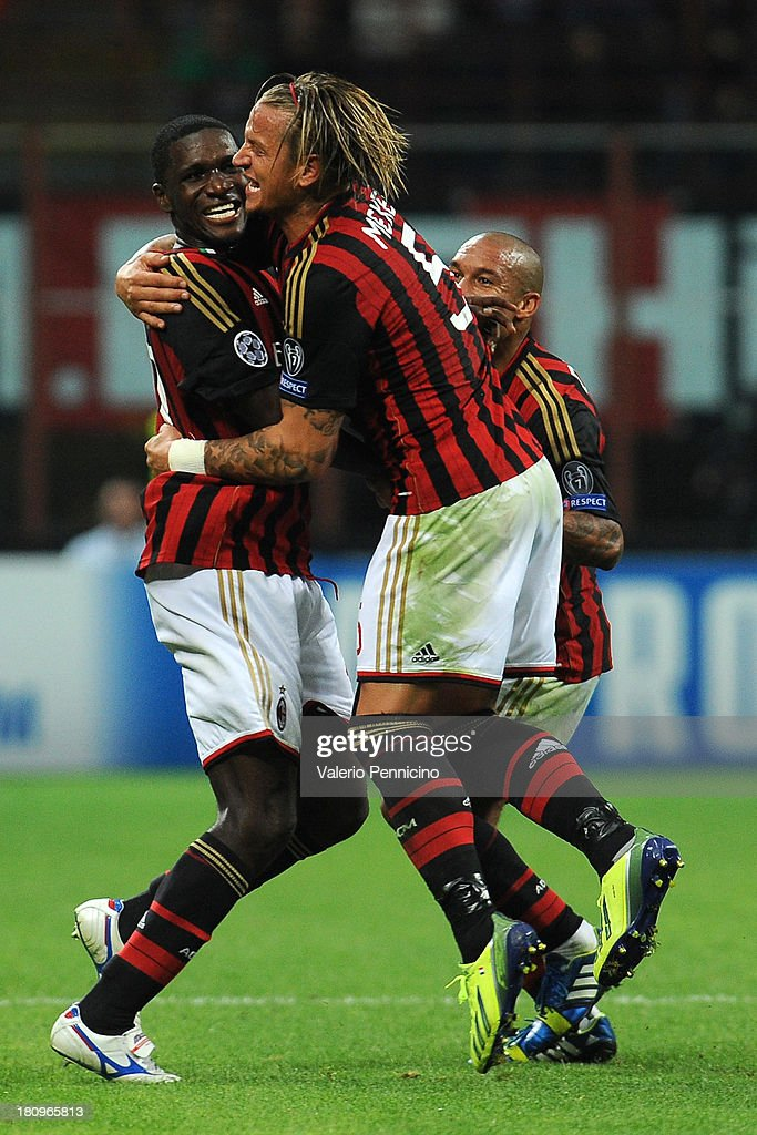 Cristian Zapata (L) of AC Milan celebrates with team-mate Philippe Mexes after scoring the opening goal during the UEFA Champions League group H match between AC Milan and Celtic at Stadio Giuseppe Meazza on September 18, 2013 in Milan, Italy.