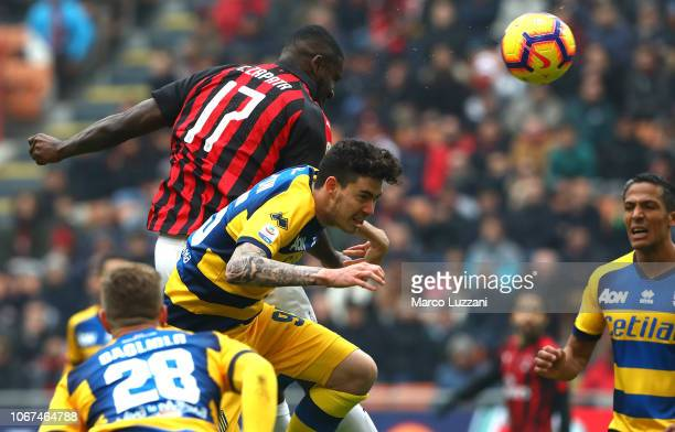 Cristian Zapata of AC Milan competes for the ball with Alessandro Bastoni of Parma Calcio during the Serie A match between AC Milan and Parma Calcio...