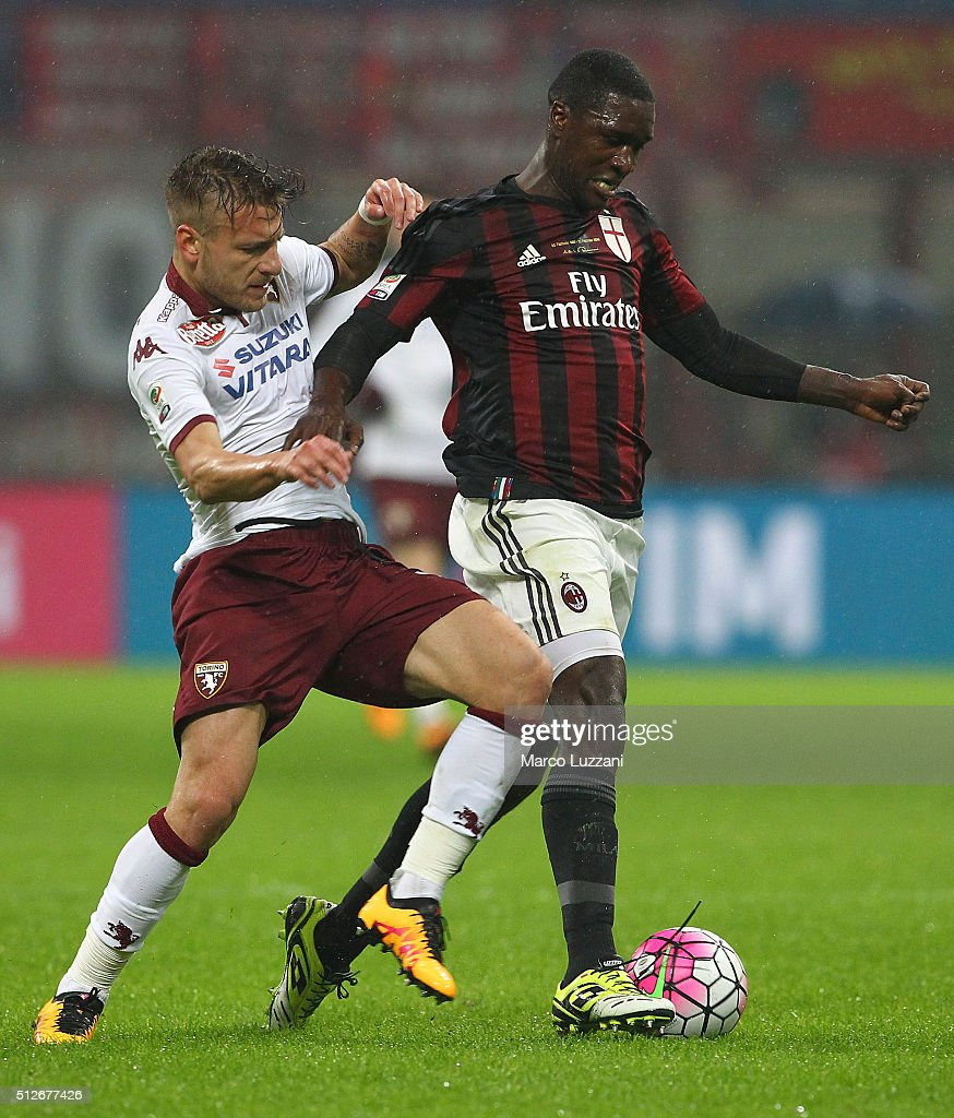 Cristian Zapata (R) of AC Milan is challenged by Ciro Immobile (L) of Torino FC during the Serie A match between AC Milan and Torino FC at Stadio Giuseppe Meazza on February 27, 2016 in Milan, Italy.