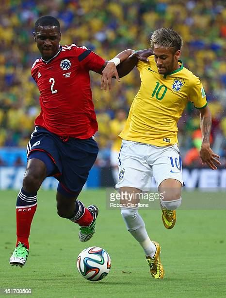 Cristian Zapata of Colombia and Neymar of Brazil compete for the ball during the 2014 FIFA World Cup Brazil Quarter Final match between Brazil and...