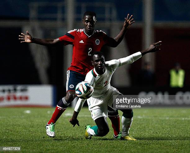 Cristian Zapata of Colombia fights for the ball with Christophe Diedhiou of Senegal during the International Friendly match between Colombia and...