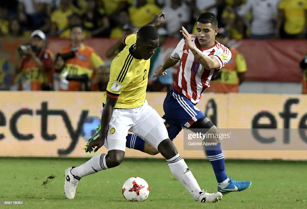 Cristian Zapata (L) of Colombia struggles for the ball with Derlis Gonzalez (R) of Paraguay during a match between Colombia and Paraguay as part of FIFA 2018 World Cup Qualifiers at Metropolitano Roberto Melendez Stadium on October 05, 2017 in Barranquilla, Colombia.