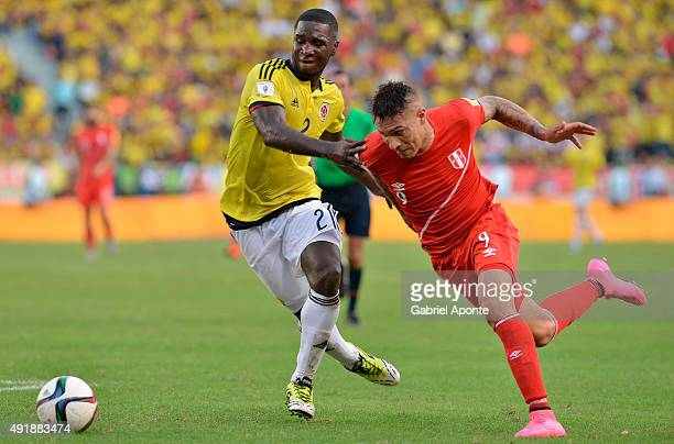 Cristian Zapata of Colombia struggles for the ball with Paolo Guerrero of Peru during a match between Colombia and Peru as part of FIFA 2018 World...