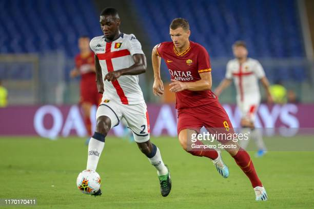 Cristian Zapata of Genoa CFC in action next to Edin Dzeko of AS Roma during the Serie A match between AS Roma and Genoa CFC at Stadio Olimpico on...