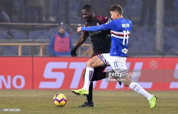 Cristian Zapata of Milan and Gaston Ramirez of Sampdoria battle for the ball during the Coppa Italia match between UC Sampdoria and AC Milan at...