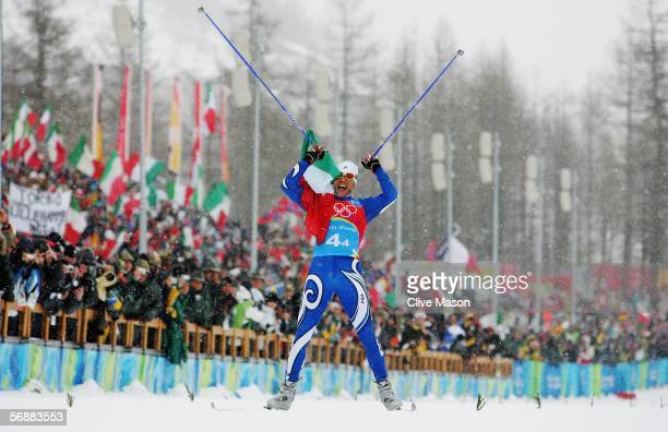 Cristian Zorzi of Italy celebrates as he crosses the line to finish first and helps Italy win the Gold Medal in the Mens Cross Country Skiing 4x10km...