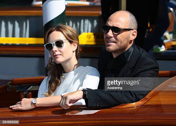 Cristiana Capotondi and Andrea Pezzi leaving from the Hotel Excelsior during the 71th Venice Film Festival in Venice Italy