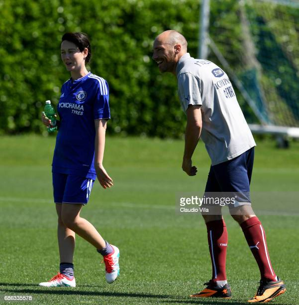 Cristiana Capotondi and Andrea Pezzi look on during a friendly match during the Italian Football Federation Kick Off Seminar on May 21 2017 in...