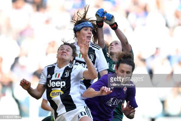 Cristiana Girelli Sofie Pedersen and Laura Giuliani of Juventus FC Women clashe with Ilaria Mauro of Fiorentina Women's FC during the Women Serie A...