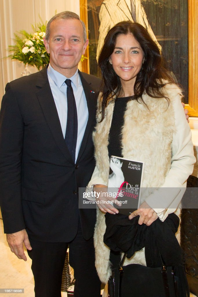 Cristiana Reali (R) and Francis Huster attend the signing of Huster's book 'And Dior Created Woman' at Dior Boutique on November 19, 2012 in Paris, France.
