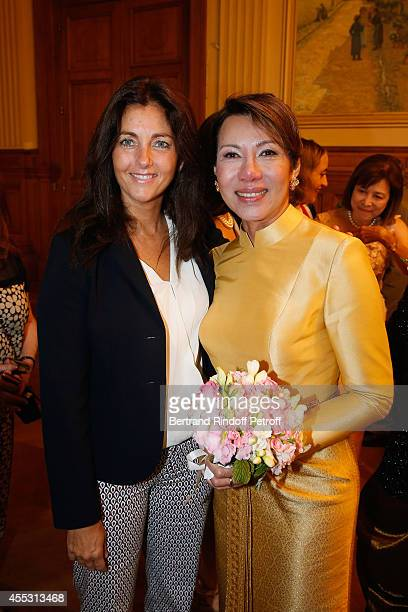 Cristiana Reali and Kanee Danevong attend the Wedding of Francois Florent And Kanee Danevong at Mairie Du XVIII on September 12 2014 in Paris France